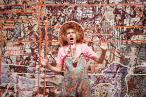 Artist Grayson Perry poses next to his work