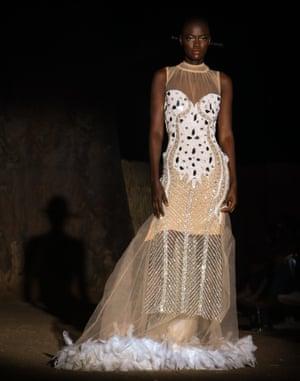 A model wears an elegant evening dress.