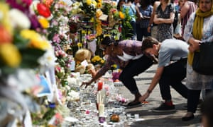 Floral tributes near Grenfell Tower in June 2017