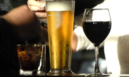A pint of beer and a glass of wine