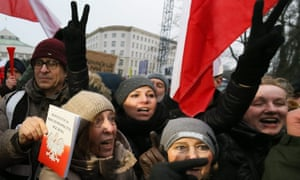 A man holds a copy of the Polish constitution at an anti-government protest in December.