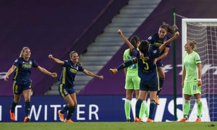 Saki Kumagai (No 5) celebrates her goal for Lyon.