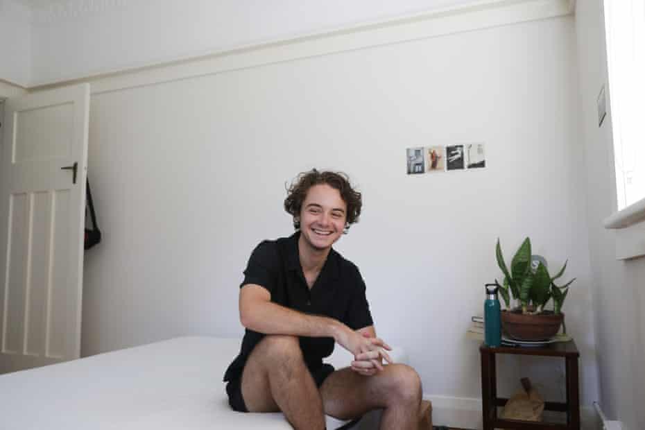 Remy Boyd sitting on a bed