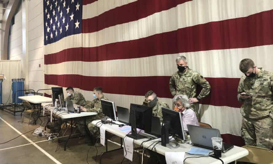 Members of the West Virginia national guard monitor statewide efforts to distribute Covid vaccines in Charleston on 14 January.