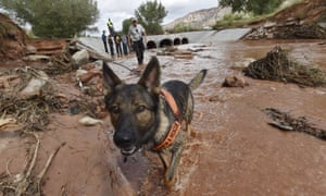 Rescuers search along the Short Creek bank after a flash flood in Hildale, Utah.