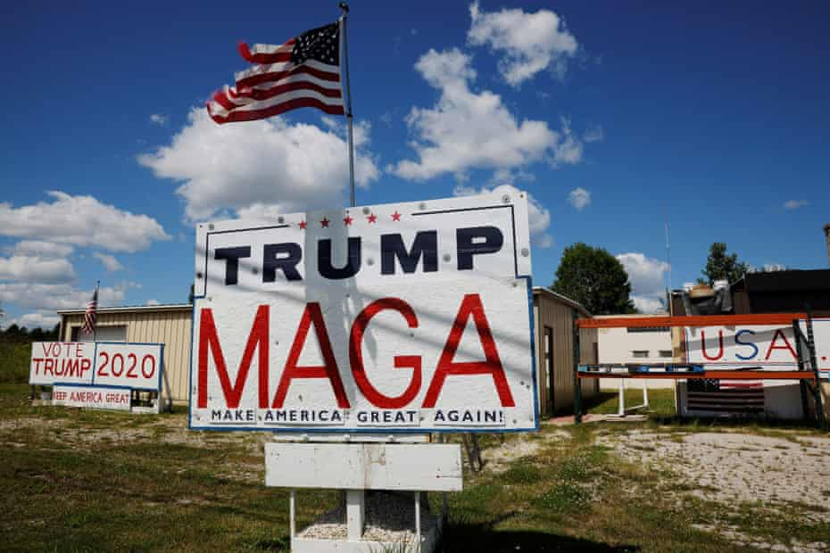 Handmade signs supporting U.S. President Donald Trump stand outside a business in Manitowoc, Wisconsin, U.S., August 18, 2020.