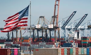 Shipping containers from China are unloaded at the Port of Los Angeles as the trade war continues.