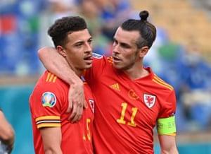 Wales' Ethan Ampadu is consoled by Gareth Bale.