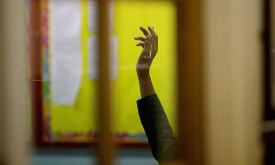 A student raises his hand.