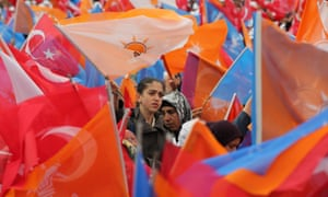 Supporters listen to Turkish prime minister Ahmet Davutoğlu at an AKP rally.