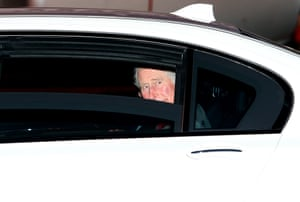 Prince Charles sneaks a peak out of a car window.