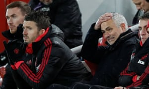 José Mourinho reacts as assistant coach Michael Carrick looks on