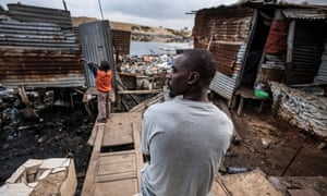 Bricklayer Artur Joao Cardoso, who lives with his two children in a shanty settlement in the south of the city