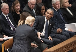 Trump shakes hands with his predecessor Obama.