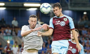 Jack Cork of Burnley heads in a goal in the extra time.