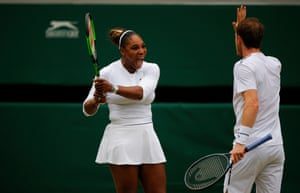 Serena Williams and Andy Murray celebrate during the first set.