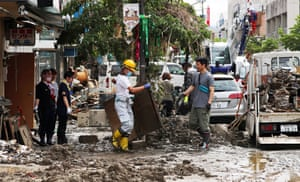 Residents clean up debris in Hitoyoshi, in Kumamoto prefecture