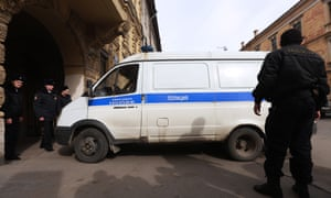 A police car arrives at St Petersburg's Oktyabrsky district court carrying suspects detained in connection with the explosion.