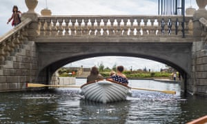 A family rows under a bridge on Great Yarmouth's newly restored waterways
