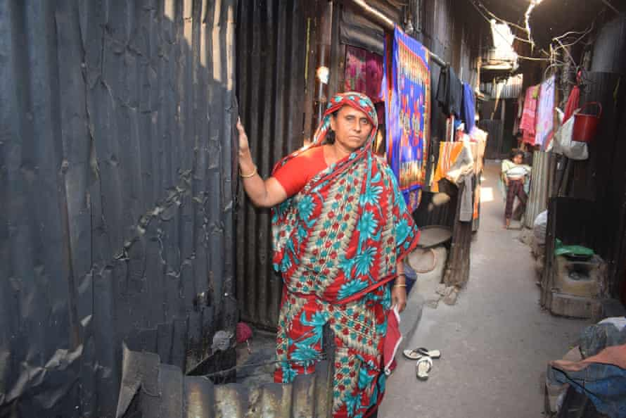 Shahida Begum outside her shack in the Kalyanpur slum. It is an unhealthy environment but it's home.