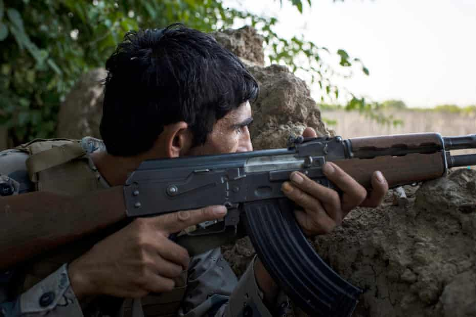 An Afghan Border Police checkpoint on the frontline at Spinah Kota, on the edge of Lashkar Gah, Helmand.