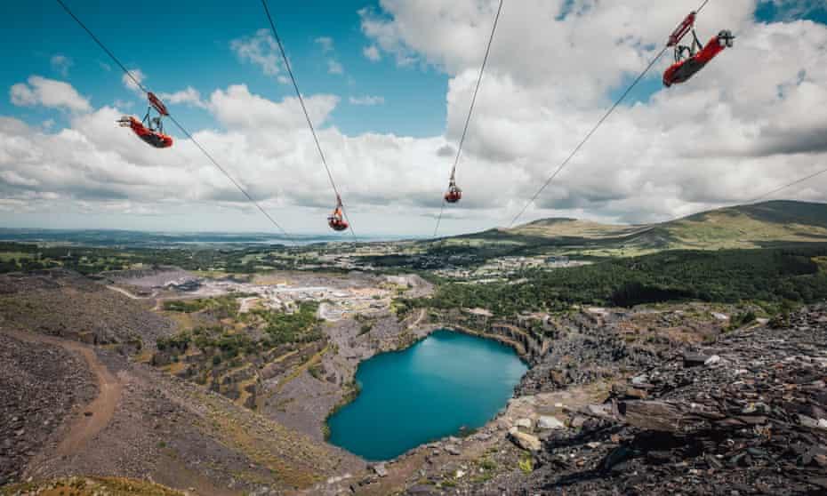 Zipworld's Velocity 2 over lake and rocky landscape