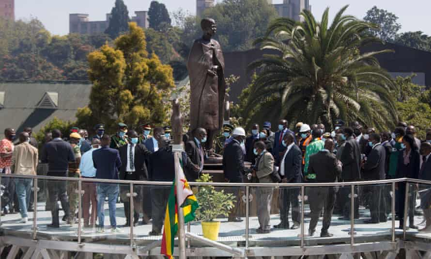 Officials gather around a statue of a spirit medium known as Mbuya Nehanda, after it was unveiled by President Emmerson Mnangagwa during the Africa Day celebrations in Harare, Zimbabwe.