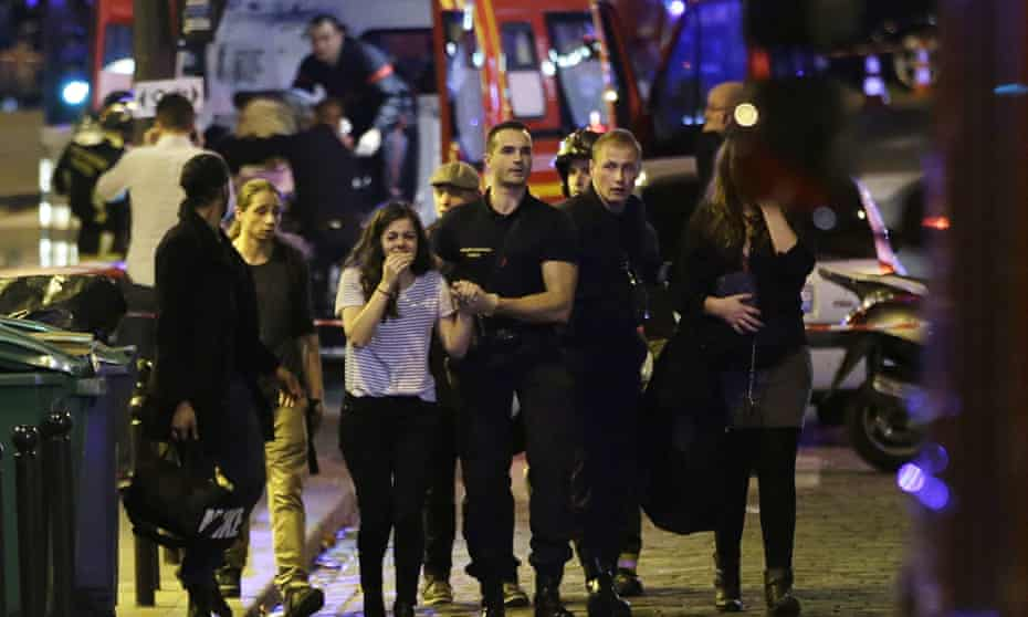 People are evacuated following the attack at the Bataclan concert venue in Paris on Friday evening.