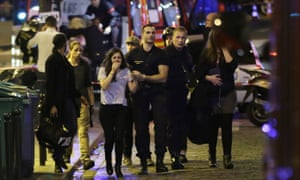 People are evacuated following an attack at the Bataclan concert venue in Paris, on 13 November 2015