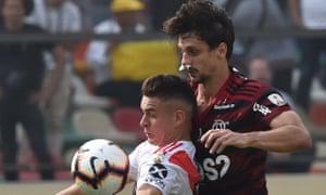 Flamengo's Rodrigo Caio (right) and River Plate's Rafael Santos Borre vie for the ball.