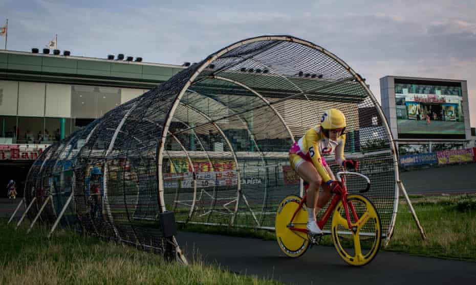 A rider enters the velodrome ahead of her race at the Kawasaki velodrome in 2015.