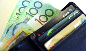 $100 Australian dollar notes pop out of a wallet