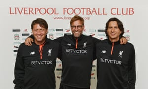 Jürgen Klopp, centre, and his assistants Peter Krawietz, left, and Zeljko Buvac. All three have signed contract extensions at Liverpool