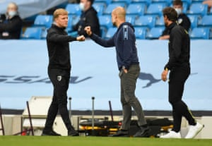 Pep Guardiola shakes hands with Eddie Howe after the match.