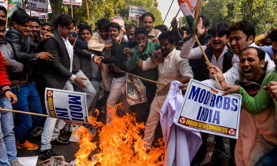 Protesters burning an effigy of billionaire jeweller Nirav Modi in New Delhi in February.