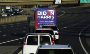 A bus carrying Joe Biden and Kamala Harris heads to a campaign stop in Phoenix, Arizona in October.
