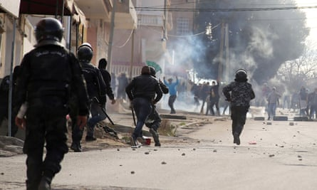Riot police and protesters in Kasserine, Tunisia, on 25 December 2018.