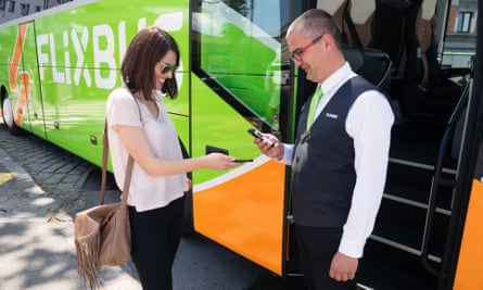 Woman showing her FlixBus pass to a conductor next to a FlixBus
