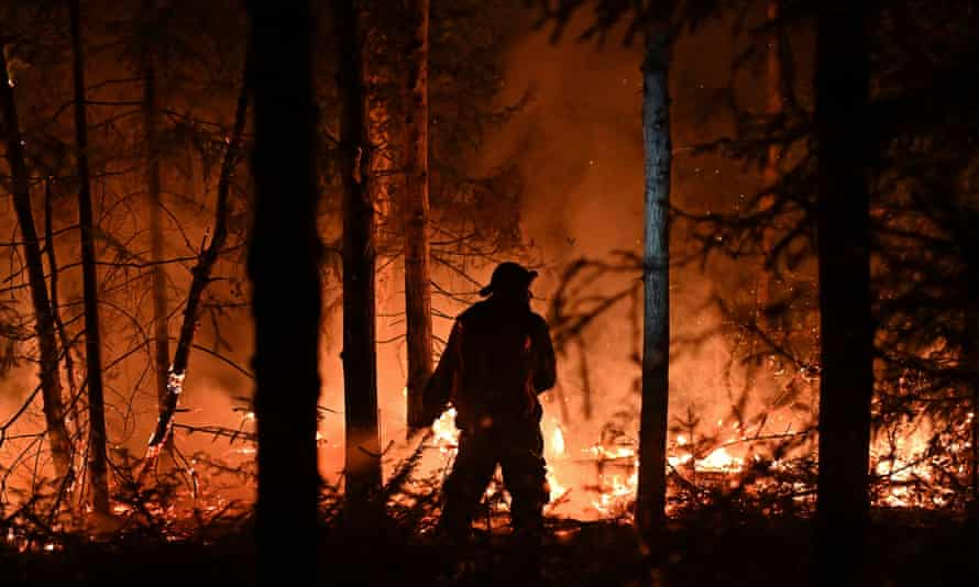A volunteer works to extinguish a wildfire near the town of Revda in Russia last month.
