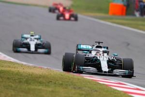 Hamilton leads Valtteri Bottas and the Ferraris during the race.