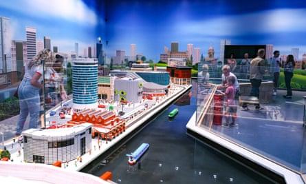 Families exploring Miniland Lego model of Birmingham at the new Legoland Discovery Centre Birmingham