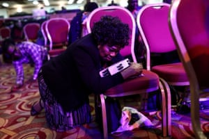 A worshipper kneels to pray during a Sunday service at the House of Praise church in Camberwell, south London