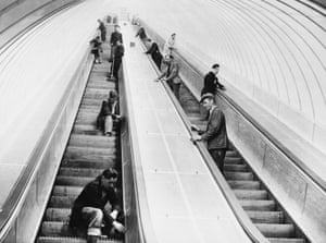1951. Workers give the wooden escalators a final clean before the Tyne Tunnel opens to the public