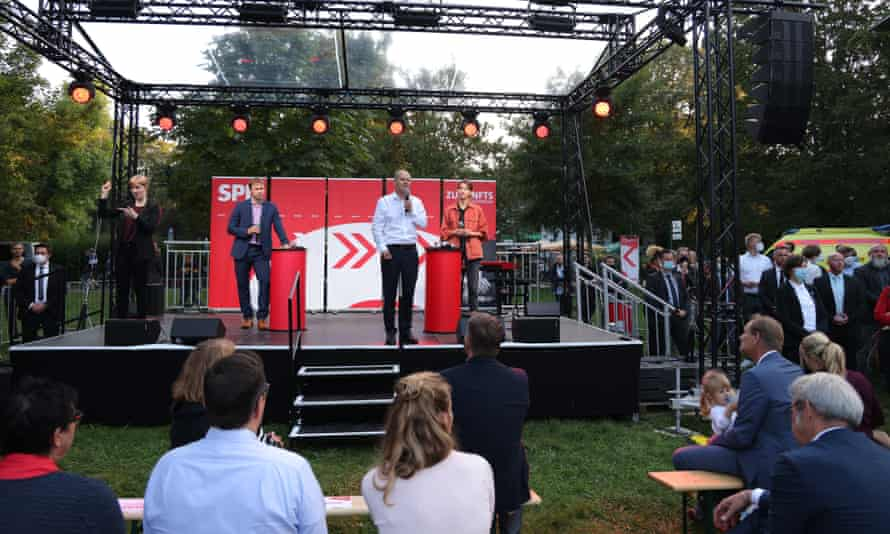 Scholz speaks at an election campaign rally in Leipzig.