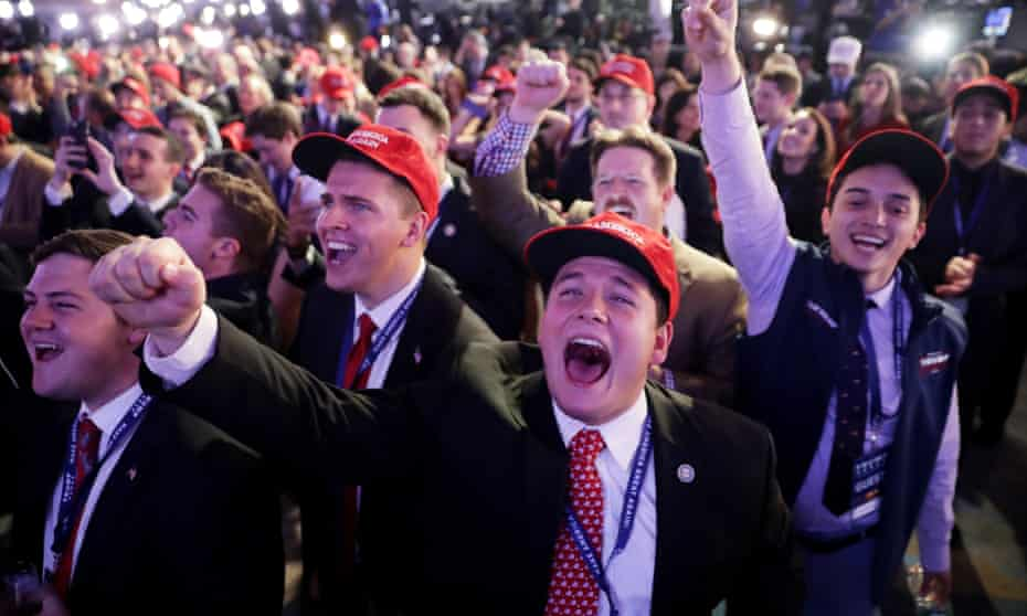 Supporters of Donald Trump cheer during his election night event at the New York Hilton Midtown on 8 November 2016