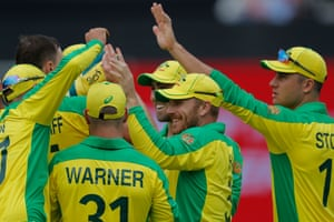 Australia captain Aaron Finch (second right) is congratulated by his teammates.