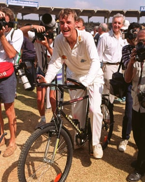 Phil Tuffnel gets on his bike.