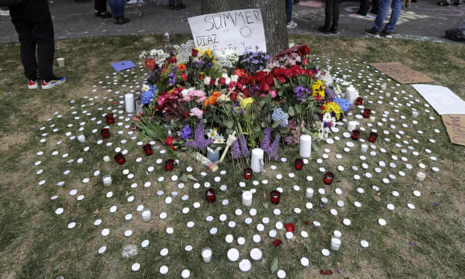 Candles and flowers form a tribute to Summer Taylor and Diaz Love during a rally near the King county courthouse, 22 July 2020, in Seattle.