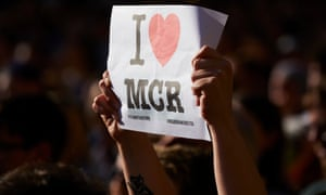 A person holds up a sign at a vigil outside the Town Hall in Albert Square, Manchester.