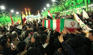 Mourners in the city of Karbala, Iraq, carry the coffins of Iraqi paramilitary chief Abu Mahdi al-Muhandis and Iranian military commander Qassem Suleimani.